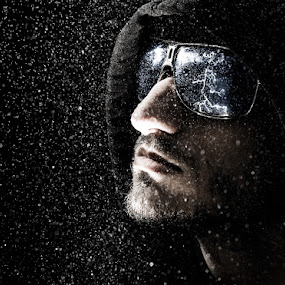 The Storm Chaser by Derek Kind - People Fine Art ( water, stormy, face, bolt, rainy, chaser, storm, sunglasses, portrait, droplets, strike, lightning, hoodie, drops, hoody, rain, man )