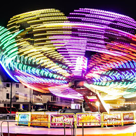 Spinning fast at the fair by Andrew Lancaster - Abstract Light Painting ( beautiful, fast, beauty, light, painting, wheel, fair, fairground, ride, lights, colours,  )