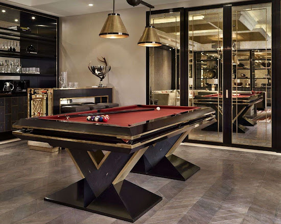 the pharaoh pool table in front of a home bar