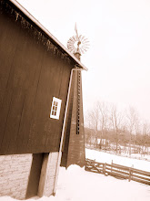 Photo: Sepia photo of a barn and windmill in the snow at Carriage Hill Metropark in Dayton, Ohio.