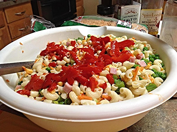 Add in the carrots, cheese cubes and chopped roasted red peppers and green &...