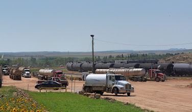 Photo: This photo in the background shows part of a unit train of tank cars on the circular track awaiting loading.
