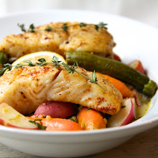 Butter Basted Halibut with Lemon Braised Baby Vegetables.