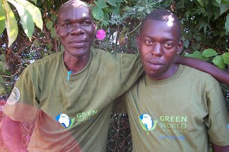 Photo: October - 16th - Community Trash Removal and Tree Planting. Solomon and one of our youth.