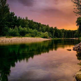 Sunset over Couer d'Alene River by Brent Huntley - Landscapes Forests ( water, reflection, brentsfavoritephotos.blogspot.com, still, northwest, travel, scenic, north, storm, kingston, landscape, tamron, photography, idaho, northern, coeur d'alene, red, sky, sunset, movement, cloud, pink, nikon, natural, river )