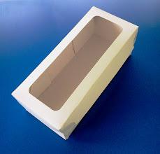Photo: Caixa (25) com abertura na tampa.