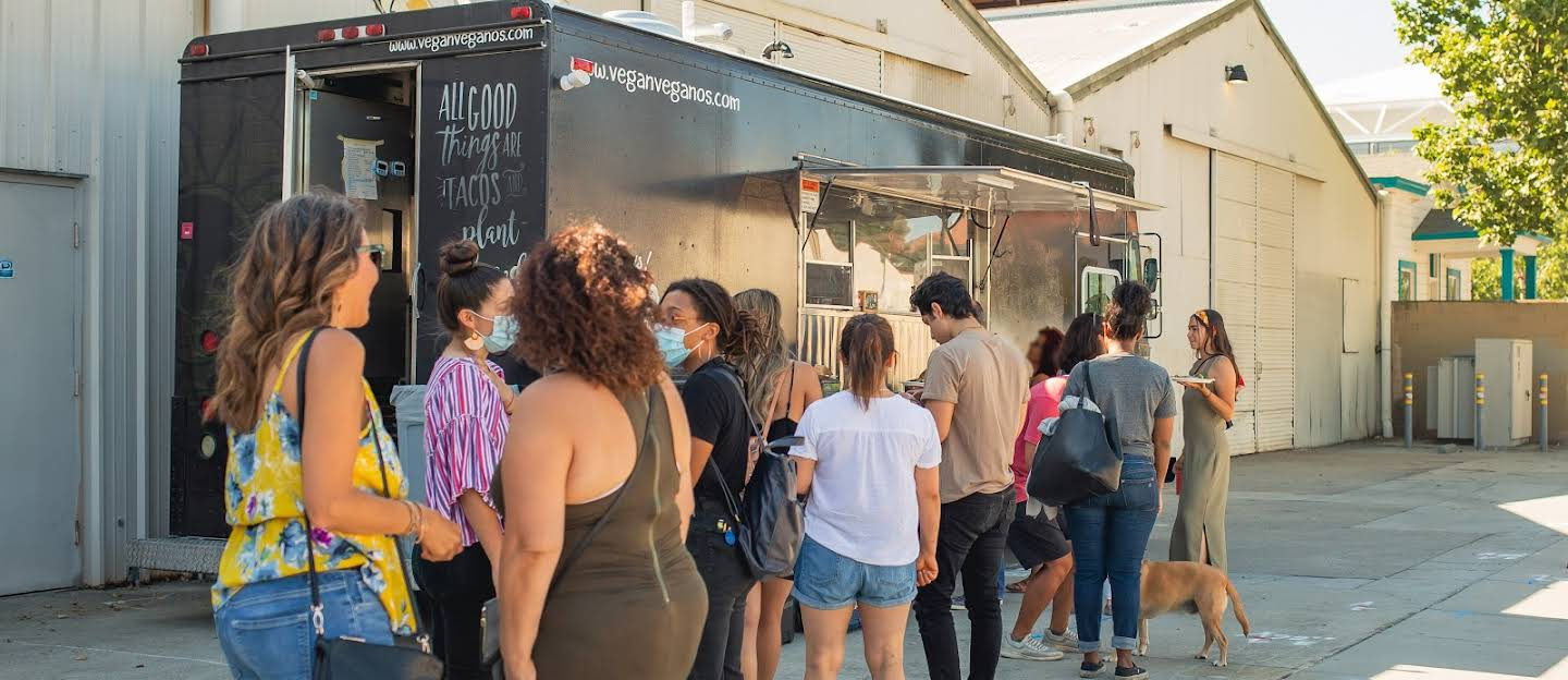 People lined up in front of the taco food truck.