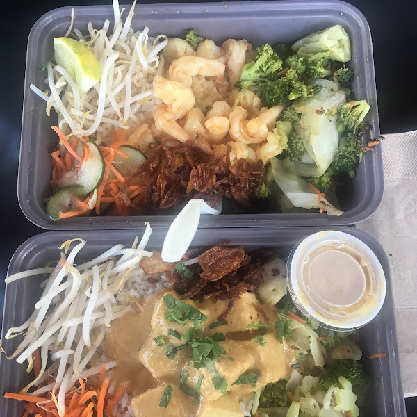 Build-Your-Own boxes! His (top): jasmine rice + shrimp + multiple toppings + fish sauce. Hers (bottom): jasmine rice + tofu + all toppings (except jalapeños) + yellow curry sauce. So good!