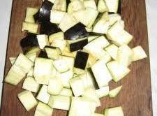 Wash the eggplants and cut them into chunks.