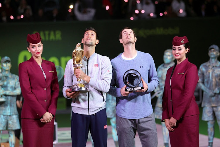 Andy Murray and Novak Djokovic receive their trophies in Doha, Qatar, on Saturday. Murry placed second. Picture: REUTERS/NASEEM ZEITOON