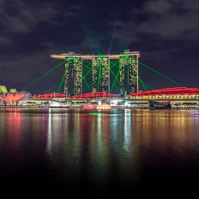 Marina Bay Sands by Martin Yon - Travel Locations Landmarks ( reflection, blue, 17-40mm, laser show, mbs, marina bay sands, laser, architecture, cityscape, singapore, blue hourd, city )