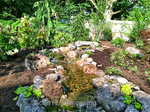 Photo: #Pondless #Waterfall Water Feature in Penfield NY. Acorn Ponds & Waterfalls, we install ponds, water features and low maintenance water gardens. Renovation and maintenance are our specialties. Check out our website www.acornponds.com and give us a call 585.442.6373.  To learn more about Landscape Design please click here: www.acornponds.com/landscape-design.html  Interested in a Waterfalls without the pond? Please click here: www.acornponds.com/pondless-waterfalls.html  For More info about Geoff and Karen's amazing project please visit: www.facebook.com/notes/acorn-landscaping-landscape-designlightingbackyard-water-gardens/landscape-design-installation-walkway-patio-rock-fountain-waterfall-in-penfield-/238744206162709  Acorn Pond & Waterfalls of Rochester NY, 585-442-6373, is a Certified Aquascape Contractor, Landscape Designer, Outdoor Lighting Designer, Installer, Builder, Contractor and Design Service Company from Rochester, NY. We have professional Installation and Design Services available for the following: Landscape Design Outdoor Room Design Backyard Ponds and Waterfalls Design & Construction Patios and Walkways: Paver, Stone, Brick Low Voltage Landscape Lighting LED Landscape Lighting Swimming Ponds Ecosystem Ponds LED Outdoor Lighting Retaining Walls Fountains Water Features Pondless Waterfalls Pond Maintenance and Design Aquatic and Under Water LED Lights Bubbling Boulders and Urns Natural Stone Patios and Rock Gardens Garden Ponds Outdoor Kitchens Pizza Ovens Fire Pits Fish or Koi Ponds Waterfall Ponds Low Maintenance Plantings Commercial Landscape Design Residencial Landscape Design Drainage Issues, Solutions Aquascape Rainwater Collection Systems  We serve Pittsford NY, Penfield NY, Brighton NY, Fairport NY, Webster NY, Greece NY, Victor NY, Henrietta NY, Irondequoit NY, Rush NY  Sign up for your personal design consultation here: www.acornponds.com/contact-us.html  Check out our photo albums on Pinterest here: www.pinterest.com/acornlandscape/ 