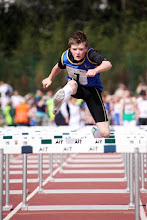 Photo: Daniel Ryan in flying form over the hurdles in the Boys U/14 80m race
