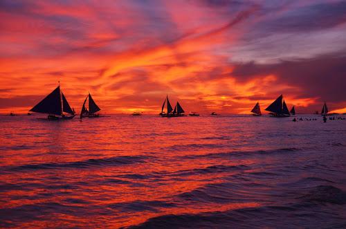 sunset by Philip Familara - Landscapes Sunsets & Sunrises ( orange, boracay, sunsets, sunset, boats, sundown, sail, sailboat, boat, philippines, island,  )