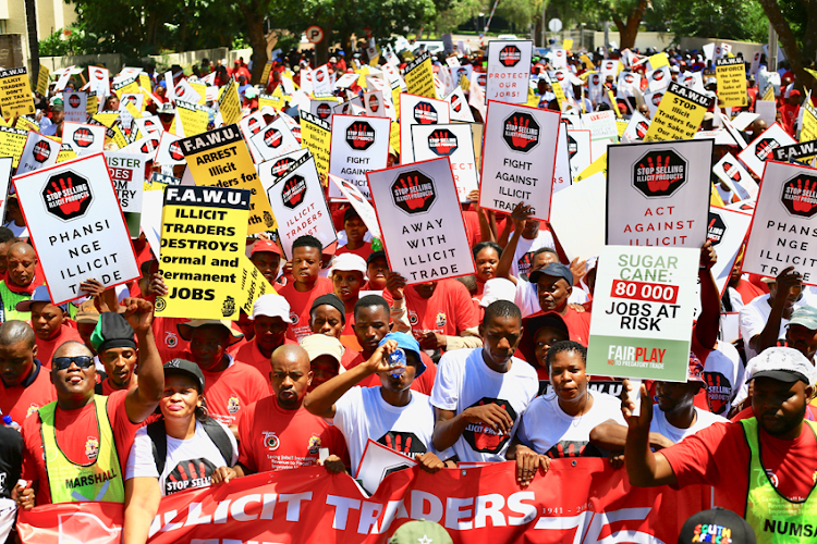 Members of Fawu and Saftu march to SARS in Johannesburg to protest against the illicit cigarette trade on Tuesday.