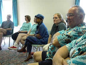 Photo: Some participants listen to the speaker as she reminds us of our grounding in God.