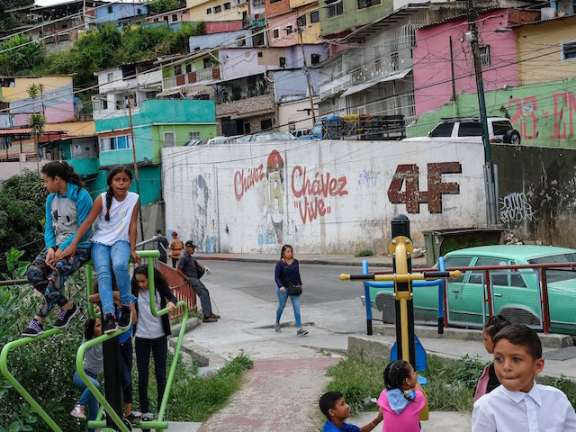 Children play at a park in 23 de Enero neighbourhood in Caracas on September 4, 2019. - In addition to the political standoff, Venezuela is suffering one of the worst economic crises in its history with a quarter of its 30 million population in need of aid, according to the …