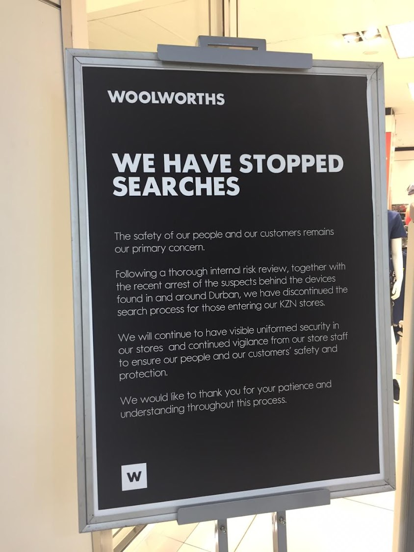A notice outside the Woolworths store in Durban's Musgrave Centre notifying shoppers that bag searches have been discontinued.