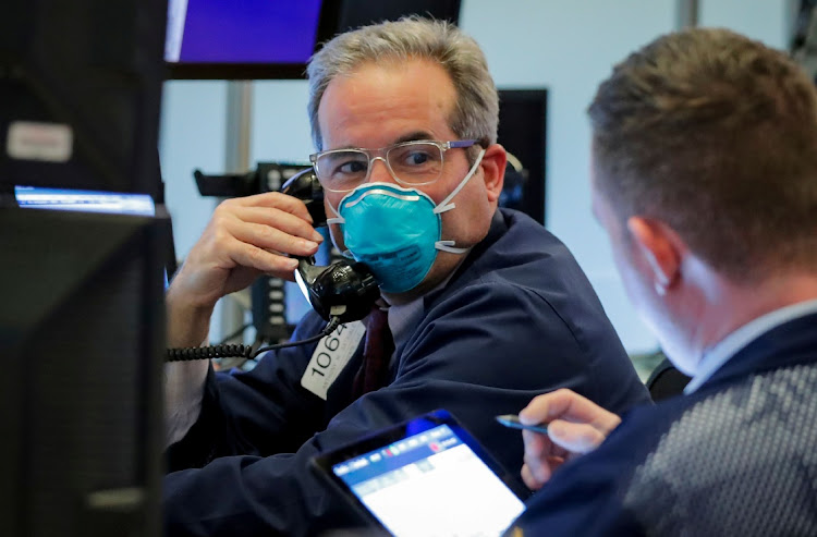 A trader wears a face mask on the floor of the New York Stock Exchange in New York, the US. Picture: REUTERS/LUCAS JACKSON