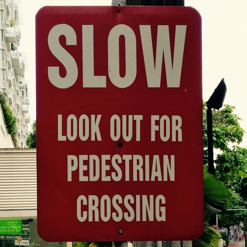 Sign: Slow -- Look out for pedestrian crossing.