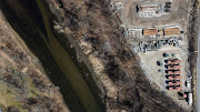 An aerial view shows the Cuyahoga River in Akron, Ohio, U.S., March 17, 2021. In 1969 the Cuyahoga River caught fire due to pollution, causing congress to pass the clean water act and the Ohio EPA was formed. Picture taken with a drone.