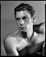 Photo: Johnny Weissmuller was a swimming star whom Hollywood called to play Tarzan (many, many times).  He gets the full start treatment, but with more emphasis on his physique. He is perhaps even shinier than Grant.
