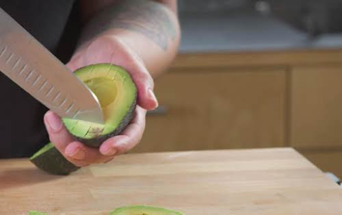 Turn avocado and score lines in the opposite direction.