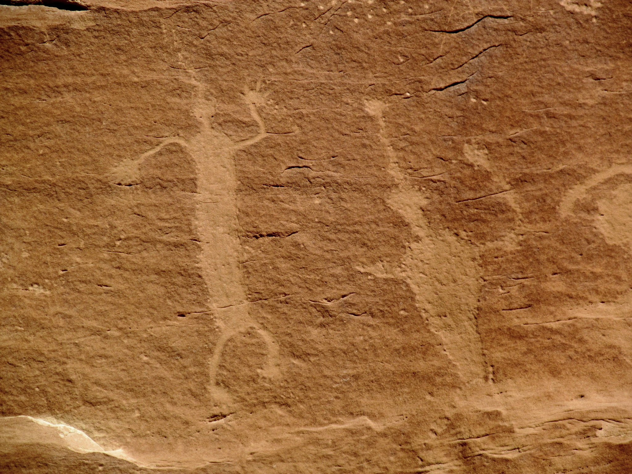 Photo: Pecked and abraded human figures
