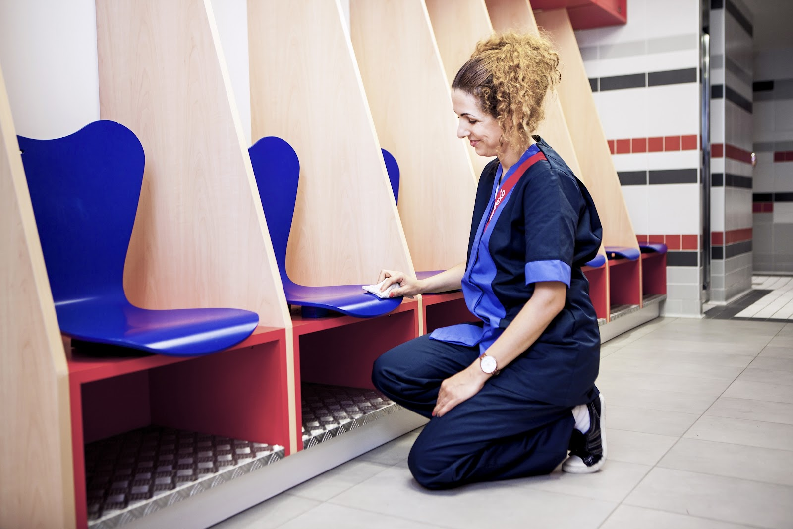 female cleaner professional cleaning a company office