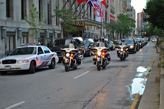 Photo: A police motorcade passes by a hotel in downtown Toronto, conducting countless drills in preparation for the G20 Summit.