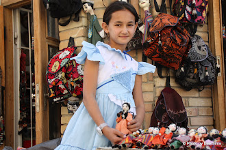 Photo: Day 164 - Young Girl with Her Dolls for Sale  (Bukhara)