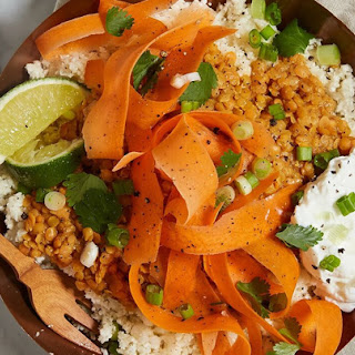 Cauliflower Rice Bowl with Curried Lentils, Carrots and Yogurt.