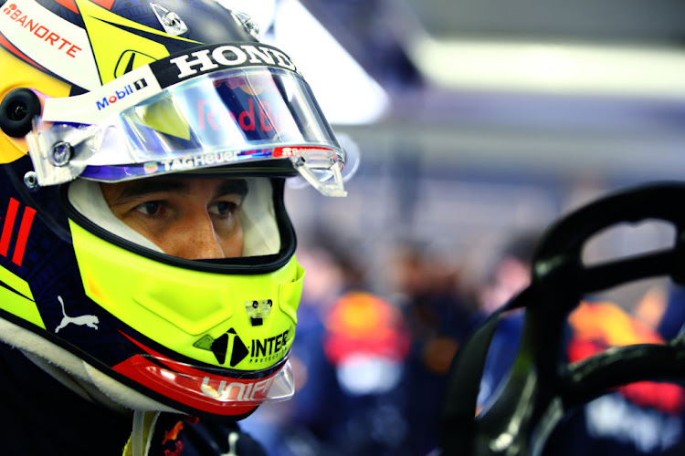 Sergio Perez of Mexico and Red Bull Racing prepares to drive in the garage during Day Two of F1 Testing at Bahrain International Circuit on March 13 2021 in Bahrain.