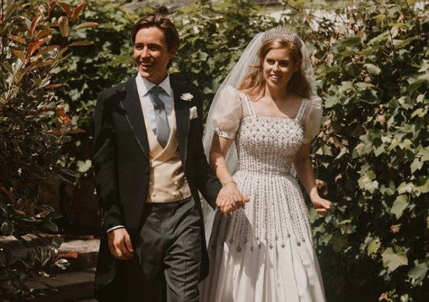 Princess Beatrice updated her grandmother's vintage gown by giving it a sleeker hemline and adding puffy sleeves for her Windsor wedding to Edoardo Mapelli Mozzi in July 2020.