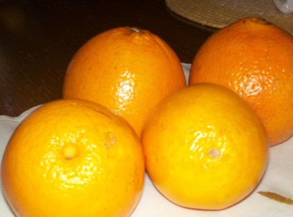 CAKE: Zest the two navel oranges and set aside (you should have approximately 1/3...
