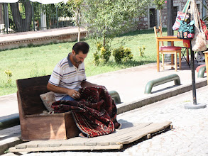 Photo: Day 110 - Man Working on his Carpets