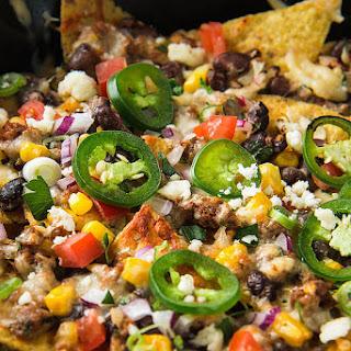 Fully Loaded Nachos with Chorizo, Black Beans, And Corn.