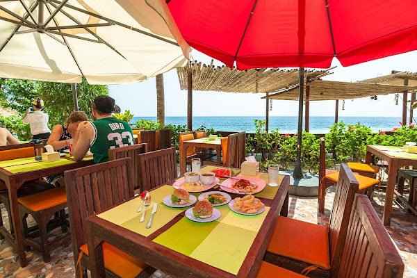 Enjoy lunch at a private beach front restaurant on Koh Yao Noi