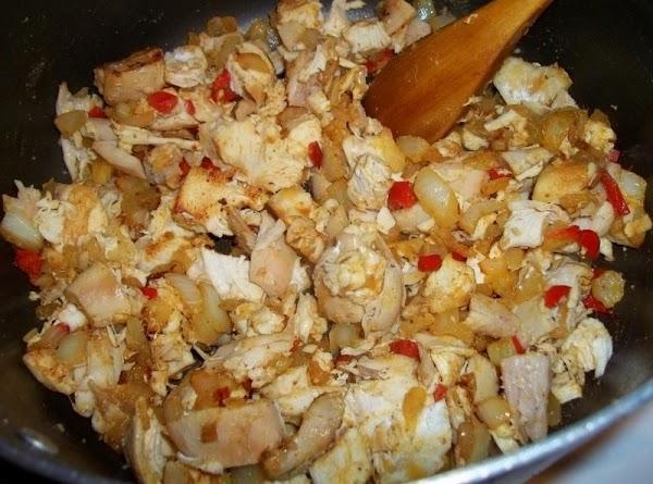 Stir in flour.  Cook for 1 - 2  minutes. Stir in half...