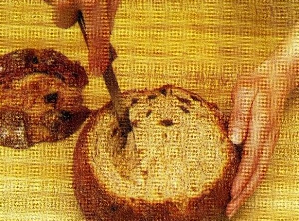 "Carve out a ""bowl"" from within the bread, leaving about 1 inch inside."