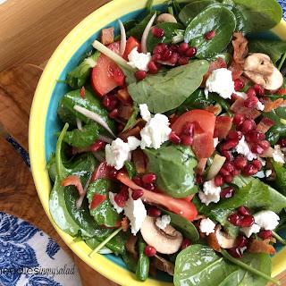 Spinach Salad With Pomegranate Vinaigrette.