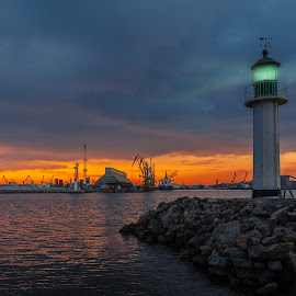 A lighthouse by Petar Shipchanov - Buildings & Architecture Places of Worship ( crane, lighthouse, port, sunset, cranes, water, sea )