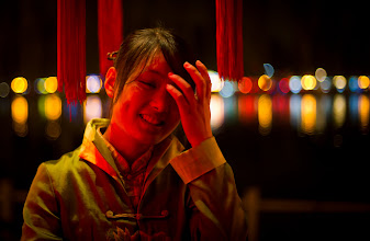 Photo: It was pretty late in the evening in Beijing, and I was tired after shooting all day long. My assistant and I stopped at a tea house along the banks of a little lake to relax. We had a very nice serving girl that kept bringing us more and more food and drinks. I think she expected us to eat in a dainty way, but we most certainly did not.  She had a pleasant disposition about her, so I asked if I could take a quick photo.