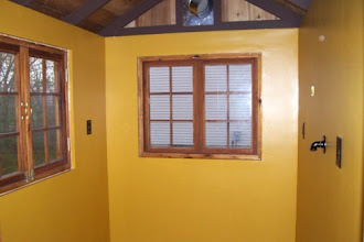 Photo: Here's a shot of the final paint job! I painted a total of 3 coats, and have enough paint left over for touch ups. Last night, I caulked around the windows and doors, installed the outlet covers as well as the cover for the gas pipe (the round black thing on the right wall). All that's really left with the windows is to paint and stain the trim. However, I can do that at any time. I'm ready to start on the floor! :)