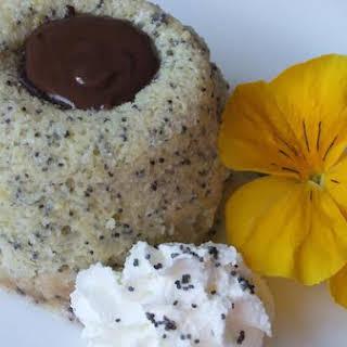 Warm Lemon Poppy Seed Cake With Chocolate Ganache Center.