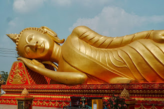 Photo: Golded sleeping buddha next door to Pha That Luang