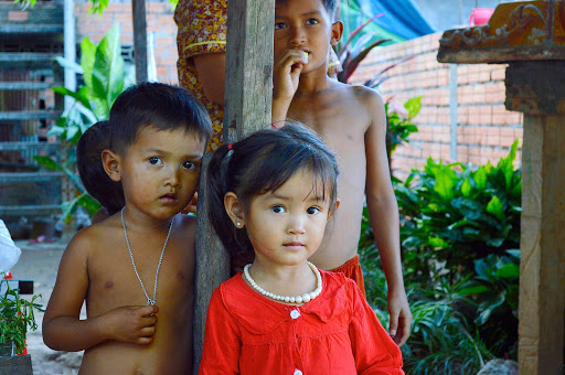 Children encountered in a Vietnam village were intensely interested in the Western visitors in their midst.
