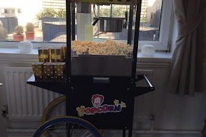 a black Popcorn Stand at an Event