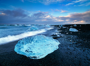 Photo: Jokulsarlon, Iceland  I was asked the other day what I'd choose if it's only one spot I can go to in Iceland. So hard to say as I built a serious passion for couple of wonderful places in there. All very different and very beautiful, with amazing photographic potential. But I must confess that Jokulsarlon and its stream mouth to the sea in the middle of cold summer nordic night, hence deserted, windy and angry, possesses a special charm that is as depressive and bizarre as can be enriching in terms of living unusual experiences. Just like finding a bunch of shining diamonds on a dark and dirty beach of a moaning sea...  Enjoy!