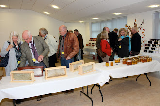 Photo: Conference delegates viewing the honey show entries